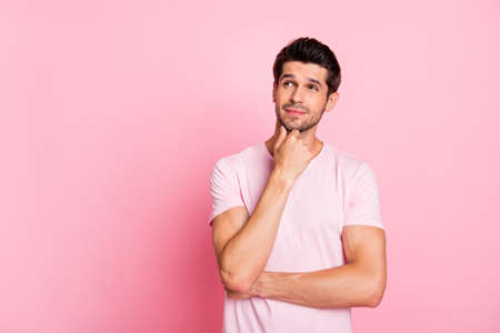 Portrait of his he nice attractive suspicious doubtful guy thinking deciding creating finding solution isolated over pink pastel background Stock Photo
