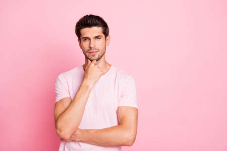 Portrait of his he nice attractive calm doubtful guy thinking deciding finding solution isolated over pink pastel background