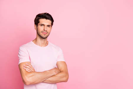 Portrait of his he nice attractive lovely sportive brutal focused calm content guy folded arms isolated over pink pastel background Stock Photo