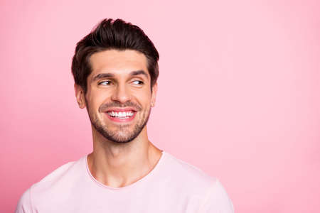 Closeup photo of amazing guy look silly empty space wearing casual outfit isolated on pink background
