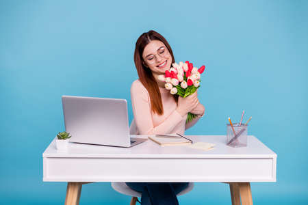 Portrait of lovely attractive cheerful glad girl getting receiving greetings congratulations on first day at work place station.isolated over bright vivid shine blue green background