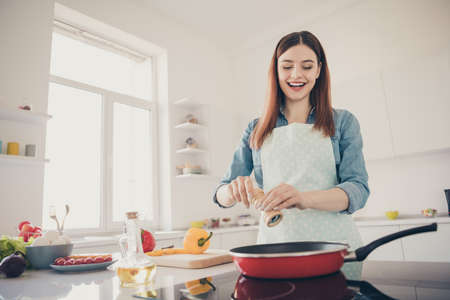 Photo of a lady in the kitchen begin to prepare family dinner Stock fotó