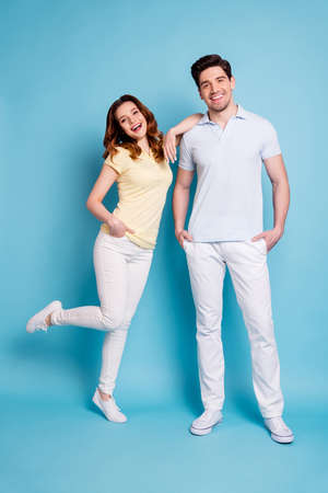 Vertical full length body size view of nice-looking attractive lovely cheerful cheery glad married spouses having fun time isolated over bright vivid shine blue green background