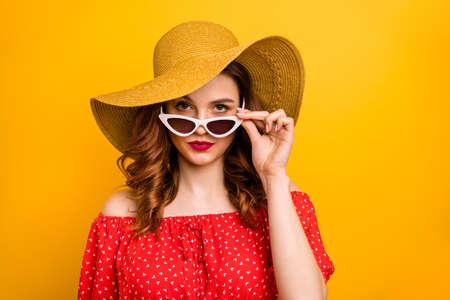 Pretty lady look window dislike rainy weather wear red dress sun specs and hat isolated yellow background Zdjęcie Seryjne