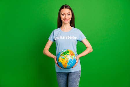 Portrait of attractive lovely girl holding a globe Zdjęcie Seryjne