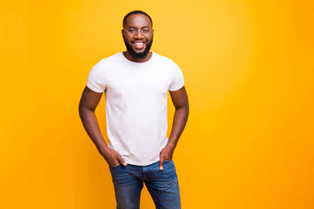 Young guy with dark skin wearing casual outfit on yellow background Reklamní fotografie - 128611626