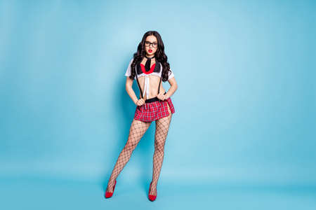 Full length photo of tender lady high school student role prostitute call wear red bra top mini skirt tights fishnet isolated blue background