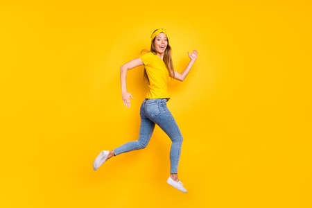 Full body photo of beautiful lady jumping high jogging wear casual clothes isolated yellow background