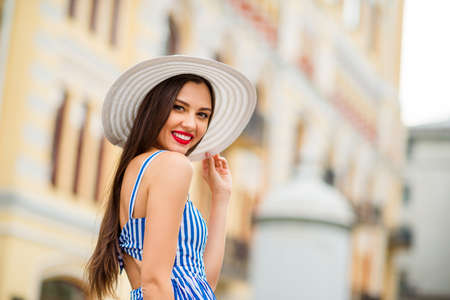 Photo of amazing lady visiting different countries abroad walking down paris street wear sun hat and blue dress