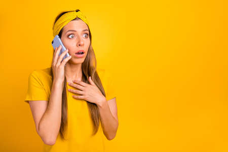 Closeup photo of pretty lady speaking over telephone hearing bad news wear casual t-shirt isolated yellow background Banco de Imagens