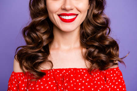 Cropped photo of beautiful lady show perfect condition beaming smile wear red dress isolated purple background Stock fotó