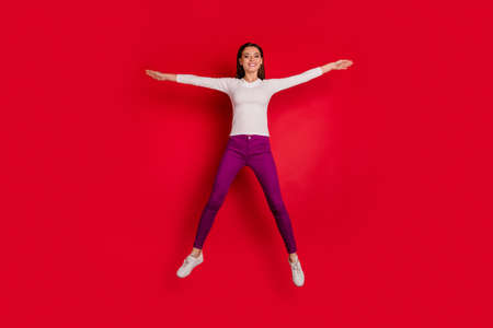 Photo of charming beautiful nice girl pretending to be star while isolated with red background Stockfoto