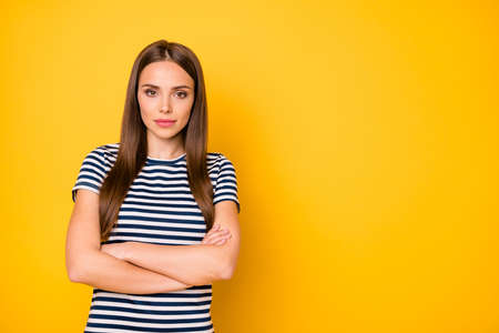Close up photo of cool lady with crossed arms company representative wear striped t-shirt isolated yellow background
