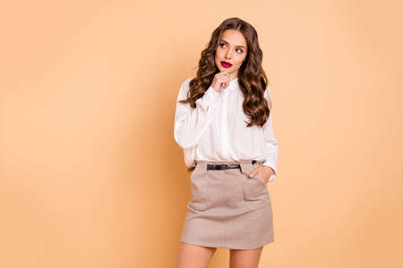Portrait of her she nice-looking attractive lovely chic glamorous pretty perfect shine content minded well-groomed lady deciding making solution isolated over beige pastel background Stock fotó