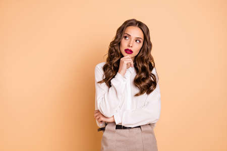Portrait of her she nice-looking attractive lovely chic gorgeous glamorous pretty winsome shine content minded well-groomed wavy-haired lady deciding isolated over beige pastel background 版權商用圖片