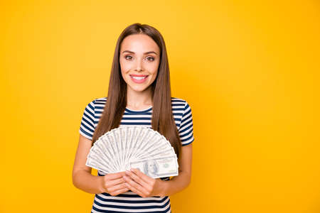 Closeup photo of pretty lady holding hands bucks fan wear striped white blue t-shirt isolated yellow background