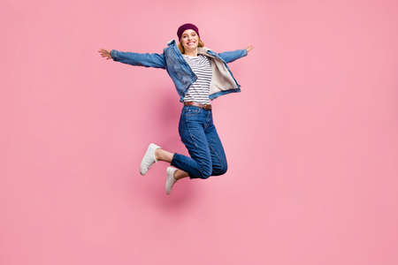 Full length body size photo of jumping excited cheerful amazed girl having learned that her boyfriend has started working as school director while isolated with pink background