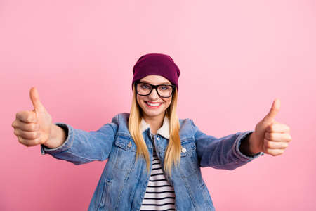 Photo of emotional glad cute woman having liked something so much that is giving you double thumb up Фото со стока