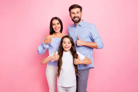 Portrait of cheerful people with wavy long hairstyle show perfect agreement wear checkered plaid shirt off-shoulders white t-shirt isolated pink background