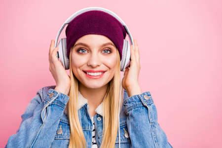 Photo of beaming toothy charming girlfriend hanging out with her playlist while isolated with pink background