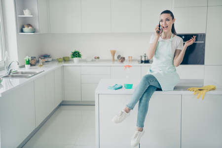 Full length body size photo of girl wearing jeans denim having decided to sit during break in order to reply to her boyfriend by phone Stock Photo - 129250450