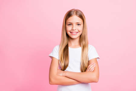 Photo of confident little girl showing brilliant intelligence for her age while isolated with pink background