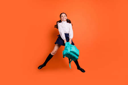 Full length body size view photo of lovely dreamy charming cute kid hold hand relax post classroom boots long socks dress white clothing blouse shirt isolated orange background 写真素材