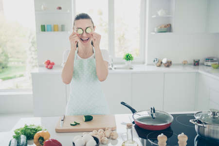 Photo of grown adult cook girlfriend who is behaving like child despite her age while cooking dinner for her husband