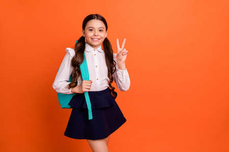 Portrait of lovely charming lady little small adorable dressed white blouse dress black feel positive cheerful have break pause isolated orange background