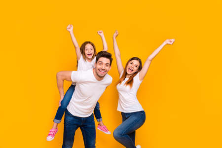Portrait of three nice attractive charming cute lovely stylish cheerful cheery childish playful glad ecstatic person having fun dancing isolated over bright vivid shine yellow background