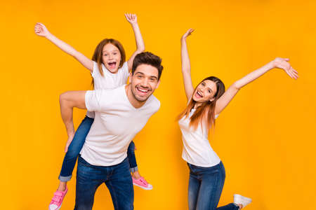 Portrait of three nice attractive charming cute lovely stylish trendy cheerful cheery carefree playful glad person having fun time dancing isolated over bright vivid shine yellow background 写真素材 - 129277325