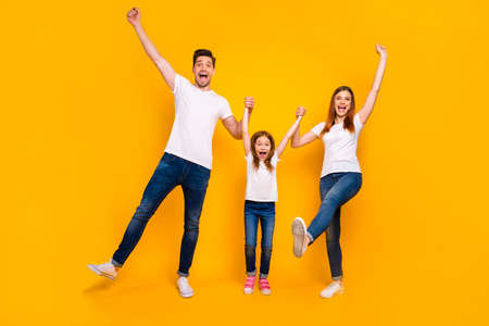 Full length body size view of three nice attractive charming lovely stylish cheerful cheery ecstatic playful person having fun time weekend rejoicing isolated over bright vivid shine yellow background