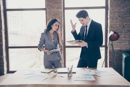 Photo of two yelling business people partners standing workshop office dressed formal wear suits Stock Photo