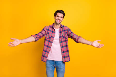 Photo of man opening his arms wide to hug his girlfriend he has not seen for ages while isolated with yellow background Banco de Imagens