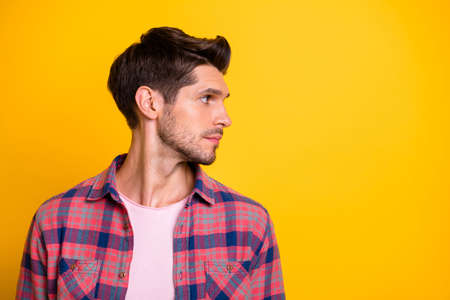 Photo of handsome thoughtful man staring at empty space like having lost in thoughts while isolated with yellow background