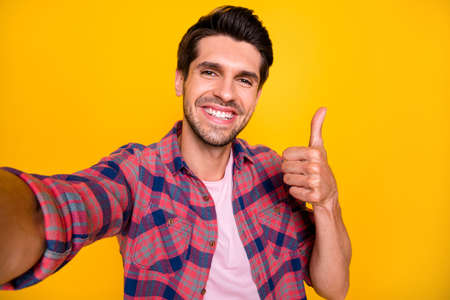 Photo of handsome man showing his teeth after having returned from dentistry clinic while isolated with yellow background