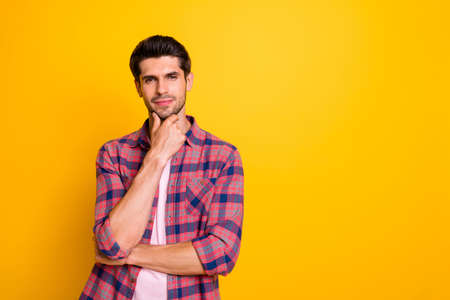 Photo of thoughtful interested wondered man thinking over his future plans to go abroad while isolated with yellow background