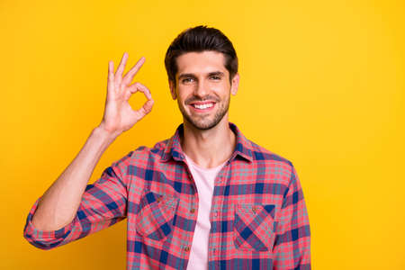 Photo of good man giving all people his charming beaming shiny smile while isolated with yellow background