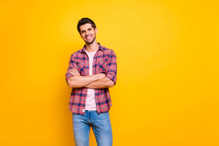 Photo of nice handsome guy having learned that he is much smarter than he has been thinking before while isolated with yellow background