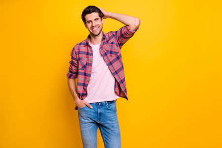 Photo of cheerful careless casual guy playing fashion model while isolated with vivid background