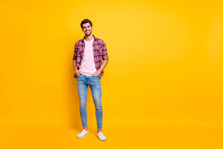Full length body size photo of enjoying guy posing in front of camera while isolated with yellow background Zdjęcie Seryjne