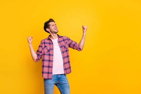 Photo of rejoicing overjoyed man having been promoted at work while isolated with vivid background