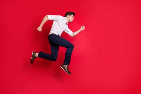 Full length body size photo of rapidly running man concentrated on some goal ahead while isolated with red background Stock fotó - 129277897