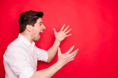 Close up photo of raging screaming awful awkward man driven mad insane with his business while isolated with red background