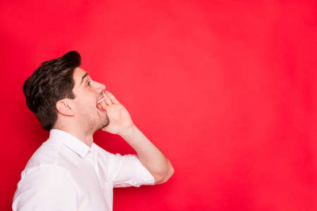 Clode up photo of funny businessman shouting to someone above while isolated with red background 写真素材 - 129277902