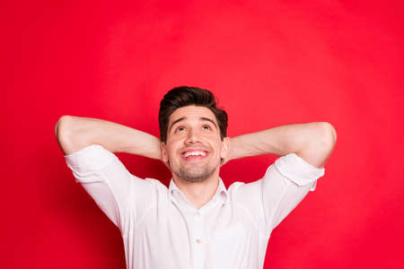 Close-up portrait of his he nice attractive lovely cheerful cheery glad content guy enjoying free time looking up isolated over bright vivid shine red background 写真素材 - 129277942
