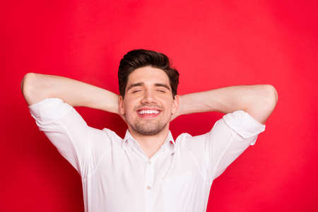 Close-up portrait of his he nice attractive lovely cheerful cheery positive peaceful guy enjoying free time weekend closed eyes isolated over bright vivid shine red background Zdjęcie Seryjne
