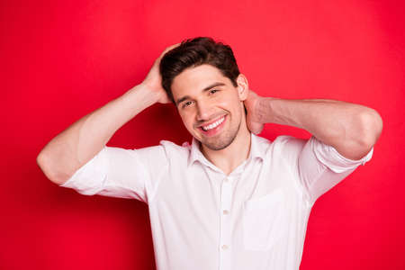 Close up photo of handsome man showing his attractiveness via camera while isolated with red background