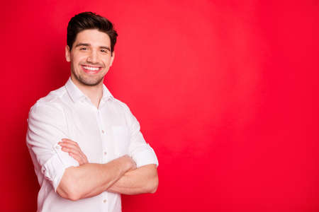 Portrait of his he nice attractive lovely cheerful cheery glad content guy representative executive director copy space isolated over bright vivid shine red background