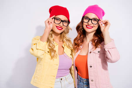 Photo of two pretty confident ladies wear specs casual clothes isolated white background Zdjęcie Seryjne